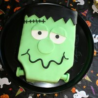 Frankenstein Fun Decorated and accented with fondant made this spooky character cute. :)