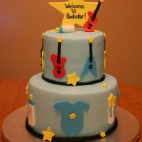 Rock Star Baby Shower For a Rock Star themed baby shower. All fondant accents, gumpaste star and guitars. I also made matching cupcakes.