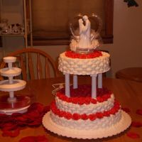 Wedding Cakewith Basketweave And Red Roses