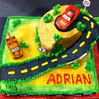 "A Car's Birthday I sculpted this cake into a slope and made a plateau with a 6"" round cake."