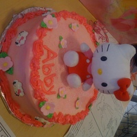 Hello Kitty This cake was a chocolate cake with butterceam icing and gumpaste flowers.