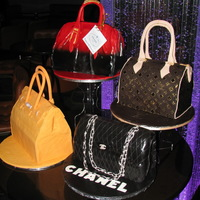 Designer Handbags   A customer celebrating her 40th in style! A Prada, Chanel, Hermes and a Louis Vuitton handbag cake. Half-Baked Ideas Inc.Toronto