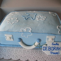 Suitcase Cake This was for a woman at my husband's office who was going on her sabatacle. It's covered in bc with fondant accents
