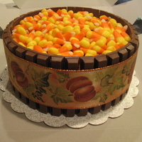 Candy Dish Cake Chocolate cake iced and filled with chocolate icing. Wrapped in Kit Kats and topped with Candy Corn. Idea from the galleries so thanks...