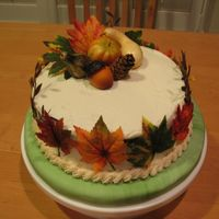 Autumn Leaves This was the 2nd cake that went with my turkey cake. They are silk/plastic leaves and fake pumpkin/gourd, etc. on it. It's a carrot...
