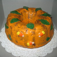 Pumpkin Bundt Cake Pumpkin Chocolate Chip Bundt Cake iced with Cinnamon Cream Cheese Glaze colored orange. Leaves are fondant and painted. From a decoration...