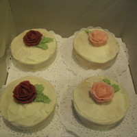 Mini Cakes I did a bunch of mini cakes for my husband's office. They are covered in cream cheese icing with bc roses and leaves.