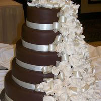 Duchess 5 tier wedding cake w/dark chocolate choco-pan fondant and gumpaste roses.Our very first wedding cake !!!!