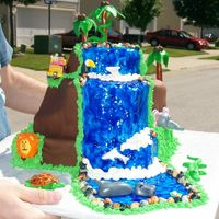 Meet Me At The Watering Hole This cake was done for a client who was having a safari themed b-day. The little b-day girl loves waterfalls and insisted that Dora &...