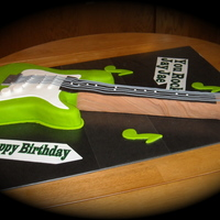 Fender Guitar For Jj Chocolate Cake with Lime vanilla Chocolate Fondant and the rest with regular fondant. The lime was on the soft side so had several holes,...