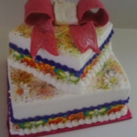 Colorful   4 + 7 inch squares, white cake, BC icing, Fondant Bow, Ribbon. TFL
