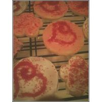 Valentine Cookies 1st attempt on sugar cookies. Made 300 for my nephews school and daycare. The first 100 came out pretty good but after that I got tired. I...