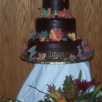 Autumn Wedding Cake I did this cake for my brother's wedding in 2005, I just came across the picture recently. Cracked chocolate ganache icing. (It was a...