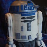R2-D2 I did this cake for my nephews birthday. It was my first sculpted cake. His legs were rkt, everything else was cake and fondant.