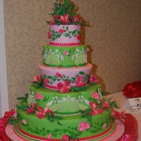 Wassa Cake Show Entry 2010 I did this cake for the Washington state sugar artists cake show. Brush embroidered bas relief flowers and appliqué leaves on...