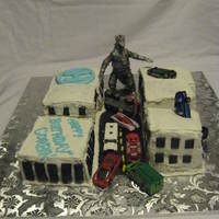 Mecha Godzilla Birthday Cake Birthday Cake for A Huge Godzilla Fan! Little Buildings are Buttercream and Marshmallow Fondant windows. Cars and Mecha Godzilla are toys...
