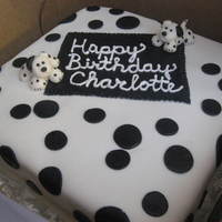 Black And White Dalmation Birthday Cake White Cake with Raspberry Filling, Vanilla Icing, and Marshmallow Fondant!