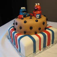 Elmo And Cookie Monster Cookie Cake Elmo and Cookie Monster on top os a huge cookie!