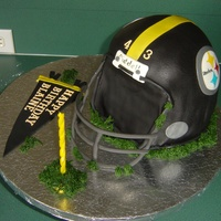 Steeler Helmet Cake This was what resulted after a toppled cake the morning it was due. I had such help from many on the forum that I got this done and it...
