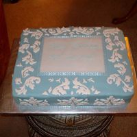 Wedgwood Blue Damask Look Cake Fondant covered with royal icing decorations. Ribbon trim. Birthday cake for 2 young ladies who wanted half chocolate frosting, half white...