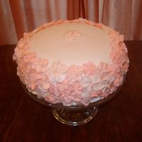Mothers_Birthday_Cake_011.jpg Fondant over rounded cake with 3 shades and sizes of royal icing flowers