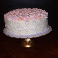007.jpg Mother's day cake. Buttercream with color dusted royal icing flowers.
