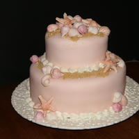 "Seashell Birthday Cake fondant covered chocolate cake, with ""sand"" and gumpaste seashells, hand colored."