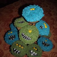 Monster Cupcakes i made these for the halloween cupcake walk at church. they were a huge hit! the idea came from patton78's cupcakes..thanks!