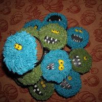 Monster Cupcakes thanks to the great talent on this site, I made these monster cupcakes. They are just buttercream icing. The blue monsters are made using a...