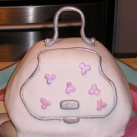 Purse Cake This was my first carved cake which was taken to a jewelery party. This was one component of a larger cake. The flavor was Strawberry Cake...