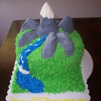 Mountain Themed Cake This is a mountain themed cake that I did for a friend. Marble cake, with vanilla BC.
