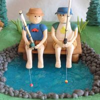 Gone Fishing  This was made for a little boy's love of fishing with his cousin. All figures and accents were made of gumpaste. This one was fun to...