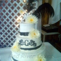 "Monogram Daisy   14"" 10"" 6"" rounds. Wedding cake with Dreamsicle icing. It was so scrumptious! Flowers are fake."