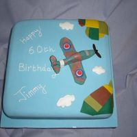 Spitfire Cake Spitfire cake make made of vanilla sponge with sugarpaste spitfire flying above patchwork fields!