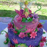 Tinkerbell Tiered Cake 6,10 in rounds buttercream covered with gumpaste decorations and store bought topper.