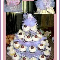 Lily's Baby Shower Cupcake Tower! I made this using Wilton's Cupcakes 'N More cupcake tower ... I wired the silver carriage to the top, added a bead-head baby,...