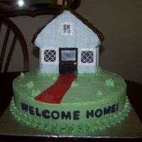 Home Sweet Home This was done for a housewarming party, wilton stand up house pan on a 12 inch round, all the colors were copied from the new home, thanks...