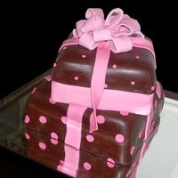 Shower Presents This is a vanilla cake with raspberry filling covered with vanilla and chocolate fondant.