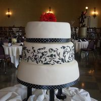 Black And White W/ Red Gerberas This cake is covered in fondant and the design is piped with royal icing to match the wedding invitations. The bride is a graphic artist...