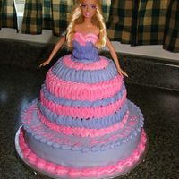"Barbie Cake Cake for niece's third birthday. She is a girlie girl and requested it have ""lots"" of pink and purple."
