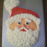 Santa Face Cake  A coworker and I did this cake for our monthly birthday party at work. It was a big hit! We used the Wilton Animal Crackers cake pan, cut...