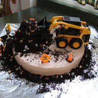 Construction Cake   This is the cake I made for my husband's birthday. He works commercial construction and always asks me to buy him a skid steer. :)