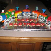 Train I made this cake with the Wilton Choo Choo and mini loaf pans.