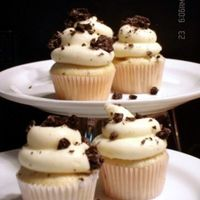 Mini Cookies And Cream Cupcakes cookies & cream batter, cream cheese icing, cookie crumbles