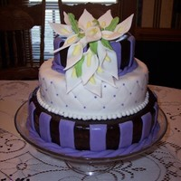 Chocolate & Lavender Calla Lily Anniversary I only used one layers for this cake because I wanted the stacked look w/o all the cake. The top and bottom layers are covered in chocolate...