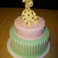 "Baby Giraffe 6"" & 8"" stacked round tiers. Baby giraffe sculped out of fondant."