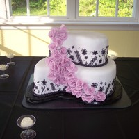 Black & White Paisley Bridal Shower Cake This was my first time using the paisley pan set. I made this cake for a bridal shower. I think it turned out cute but piping the black...
