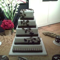 Five Tier Wedding With Vine This is the largest wedding cake that I have made. It is five tiers tall with the top, middle and bottom cakes being rum cake and the...