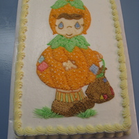 Precious Moments Pumkin Girl   1/2 sheet yellow cake, iced in buttercream