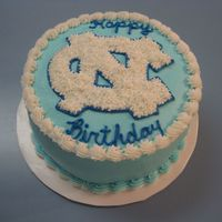 "Unc   8"" round, 3 layer marble cake with custard filling and buttercream frosting."